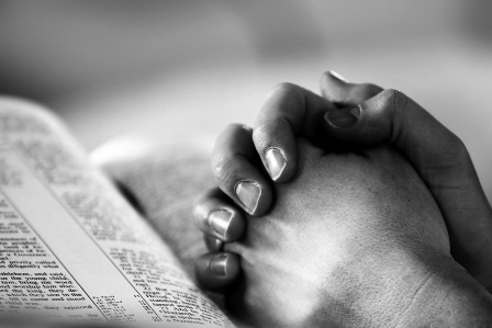 Praying Hands on Bible Black and White